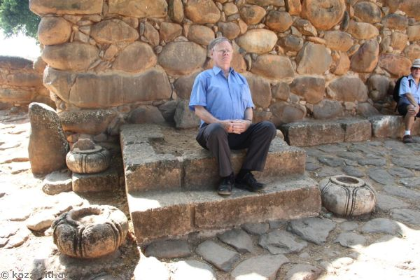 Dad sitting at the entrance square of Tel Dan