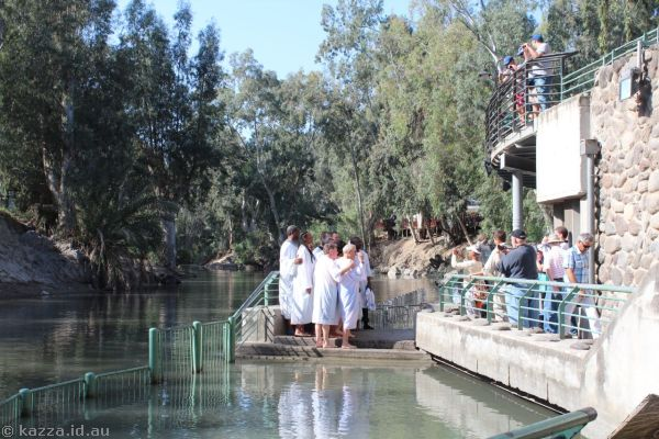 People being baptised in the Jordan River<br>Photo by Dad