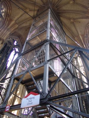 At the top of the belfry, there is a metal staircase to go the rest of the way