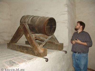 Stu inspecting a wooden cannon in the fortress