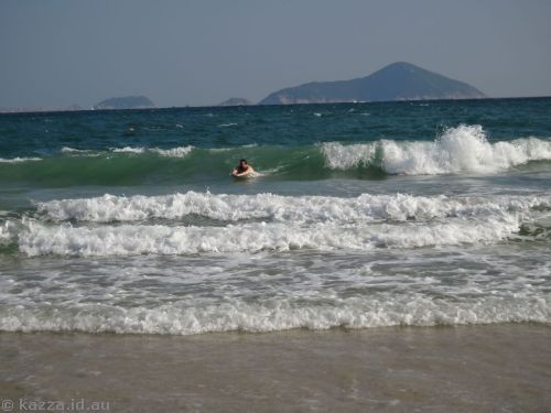 Stu body surfing at Shek O beach
