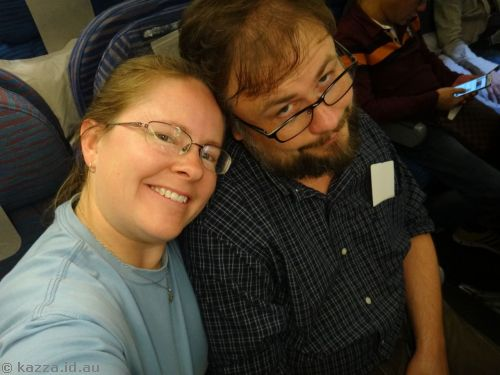 Can you tell the sweetie is thrilled to be on another plane?