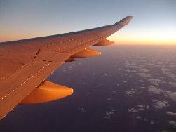 Sunrise over a Boeing 747-400 wing