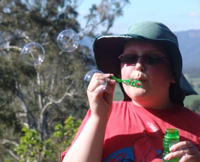 Joel blowing bubbles