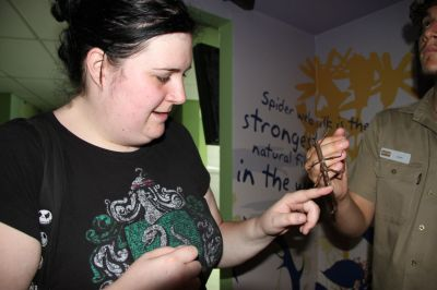 Kore patting a stick insect