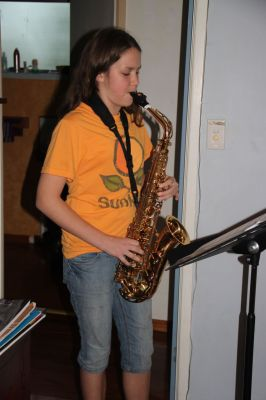 K playing her saxophone