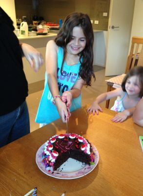 Lily cutting her cake (again)