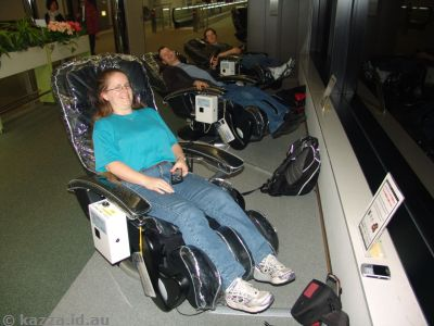 Relaxing in the massage chairs at the airport