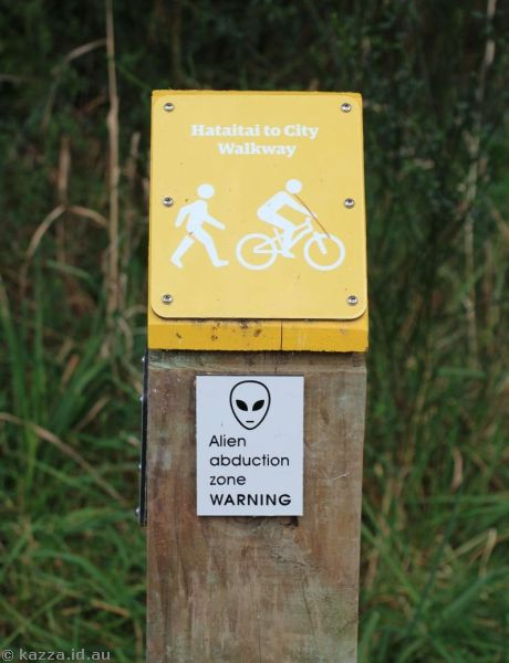 Alien abduction zone warning sign