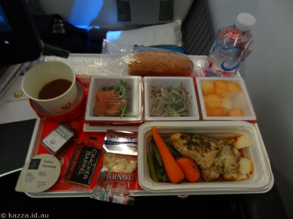 Lunch on the plane.  I had roasted chicken with honey mustard sauce, with salmon salad, Japanese soba noodles, fresh fruits, cheese and crackers and ice cream