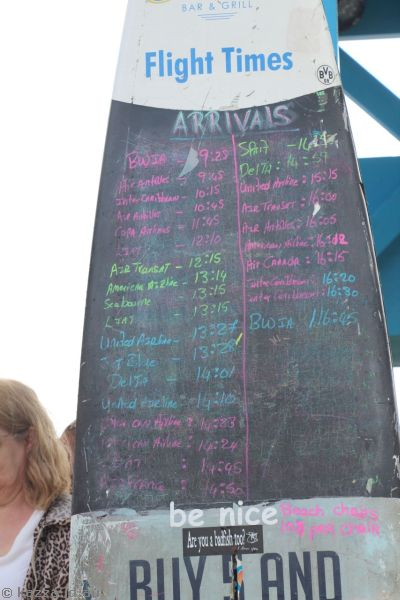 Sunset Bar surfboard showing airline arrivals times