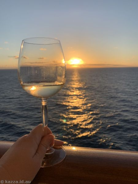 Drinking wine at sunset on our balcony