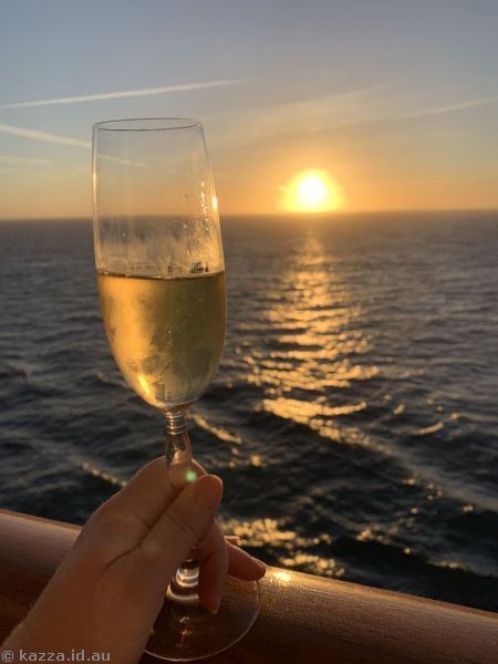 Drinking champagne at sunset on our balcony