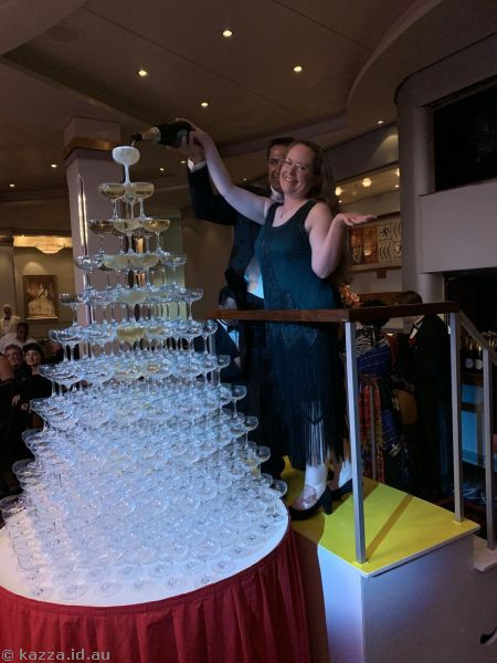Kaz pouring champagne into the champagne tower