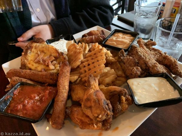 Jojo's Sampler - 4 chicken wings with choice of sauce, 4 mozzarella sticks, 3 potato skins, 3 chicken tenders, waffle fries and 2 cheese beef jalapeno poppers; served with bbw mayo, black pepper sour cream, marinara sauce and tequila sour cream