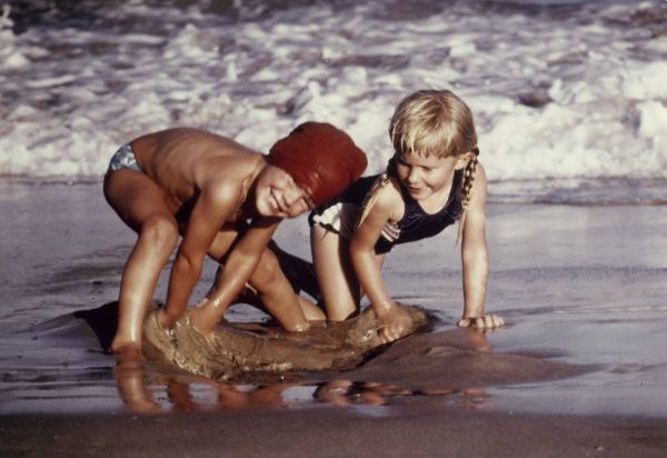 David and Karen playing in the sand at Fingal Bay