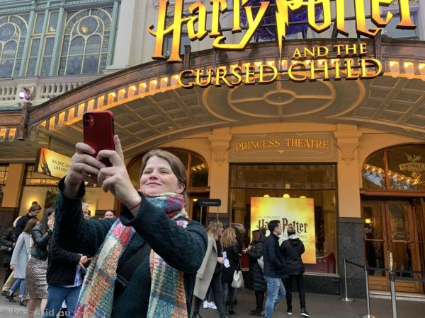 Hannah taking a selfie outside the theatre