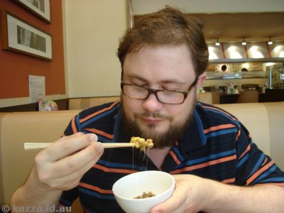 Stu eating natto in Denny's
