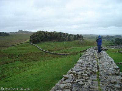 Stu on the fort wall looking out at Hadrian's Wall