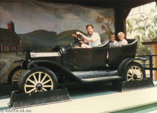 Family in a vintage car.  The background moved around on a roll so it looked like you were moving on a video