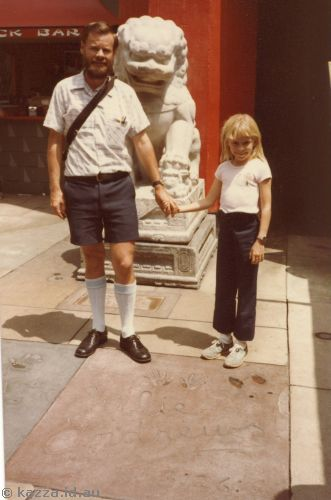 Dad and me next to Julie Andrews' hand and foot prints at Mann's Chinese Theatre